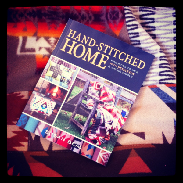 hand-stitched home book on quilt