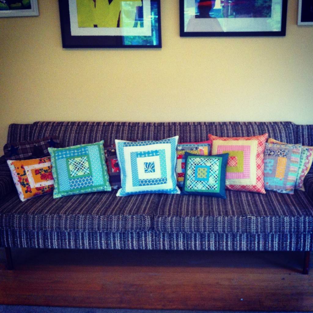a whole bunch of log cabin pillows